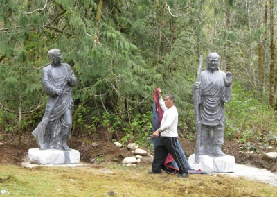 From left to right-  stoned-statue of Shide and Fenggan