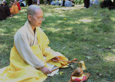 Dharma Master Jin Ji leading the recitation with the Dharma Instruments