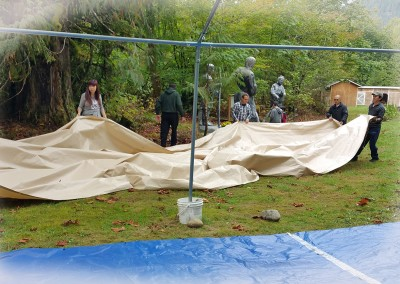 Folding up the Big Tent's covers
