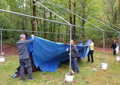 Folding up the Big Tent's ground covers