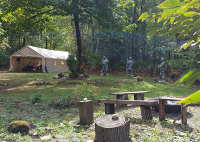 Summer Time Sessions Tent to the left of The Three Sages stoned-statues ~ view from Campfire