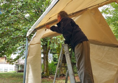 Key Donn helping with removing the Big Tent's knots