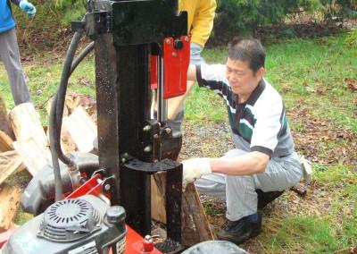 David working the wood-splitter