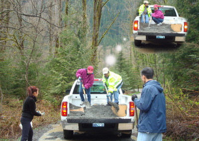 (on the pickup truck, from left to right) Chin Li, Chin Er and friends filling up driveway entrance with rocks