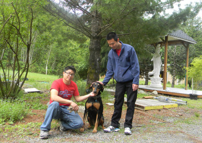 (from left to right) Albert and Alex with visiting dog
