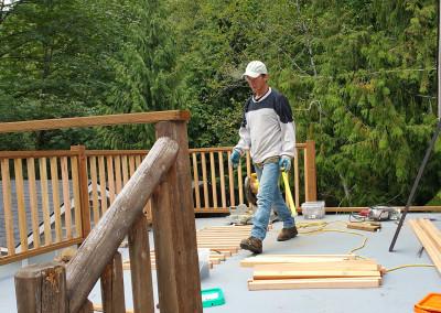 Trung renovating the deck rails