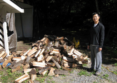 Volunteer works on new wood-plitter, July 2014