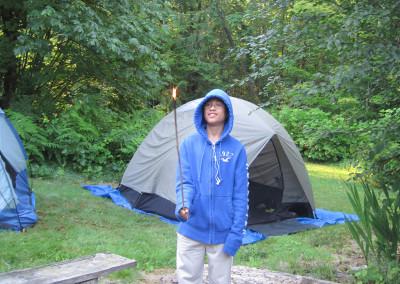 Bao-Quang testing twig dryness for campfire