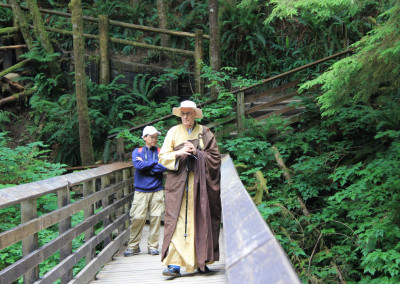 Dharma Master Heng Lai and Vinh on the bridge over the trail creek
