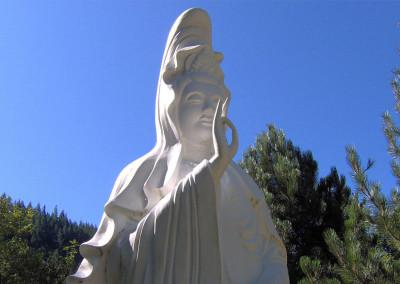 Gwan Shr Yin Bodhisattva Statue - Under summer sun blue sky