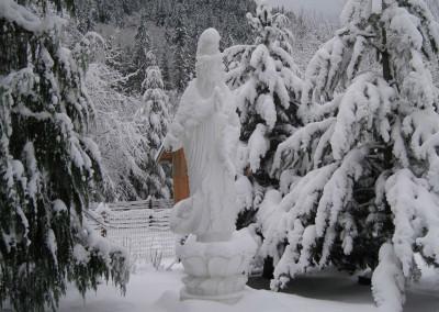 Heavy winter snow covering Gwan Shr Yin Bodhisattva