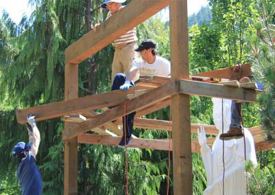 Volunteers get together in building Gwan Yin's roof